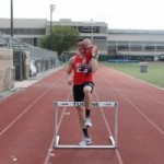 Hurdling with my son Gabriel on the Tulane track in 2012.